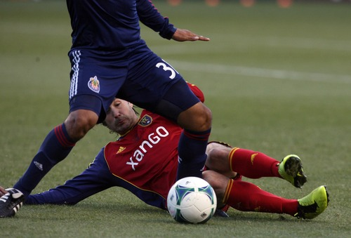 Kim Raff  |  The Salt Lake Tribune (bottom) Real Salt Lake midfielder Ned Grabavoy (20) makes a sliding tackle as Chivas USA midfielder Marvin Iraheta (31) tries to keep control of the ball at Rio Tinto Stadium in Sandy on April 20, 2013.