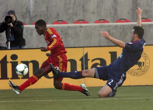 Kim Raff  |  The Salt Lake Tribune (left) Real Salt Lake forward Olmes Garcia tries to control the ball as (right) Chivas USA defender Bobby Burling (2) makes a sliding tackle during the first half at Rio Tinto Stadium in Sandy on April 20, 2013.