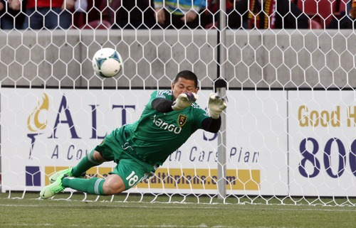 Kim Raff  |  The Salt Lake Tribune Real Salt Lake goalkeeper Nick Rimando (18) makes a diving save during a penalty kick by Chivas USA midfielder Edgar Mejia (8) during the first half of a game at Rio Tinto Stadium in Sandy on April 20, 2013.