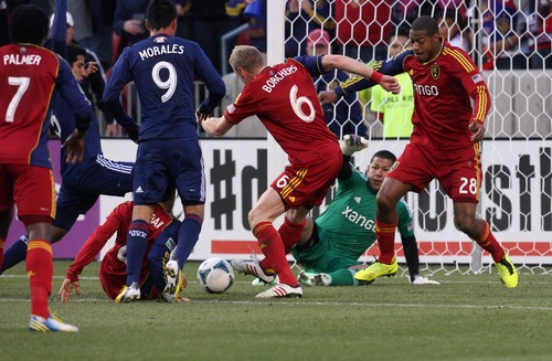 Kim Raff  |  The Salt Lake Tribune Real Salt Lake defense works to clear a ball in front of a goal after Real Salt Lake goalkeeper Nick Rimando (18) blocks a penalty kick during the first half of a game at Rio Tinto Stadium in Sandy on April 20, 2013. Real went on to win the game 1-0.
