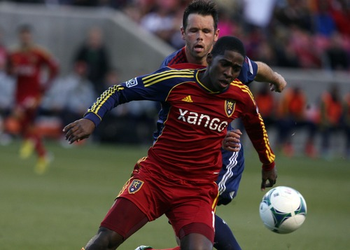 Kim Raff  |  The Salt Lake Tribune (front) Real Salt Lake forward Olmes Garcia tries to keep possession as (back) Chivas USA defender Bobby Burling (2) defends during the first half of a game at Rio Tinto Stadium in Sandy on April 20, 2013.