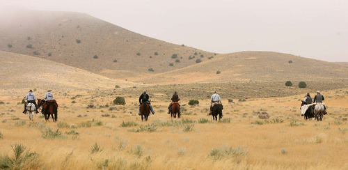 Leah Hogsten | The Salt Lake Tribune Horseman from Juab County Search and Rescue comb a wider path  along the ridgeline where human remains were found in the Topaz Mountain area. West Valley City Police and forensics investigators were joined by Juab County Search and Rescue horsemen Saturday, September 17 2011 in their resumed search in the Topaz Mountain are for the remains believed to be that of missing West Valley City woman Susan Cox Powell.
