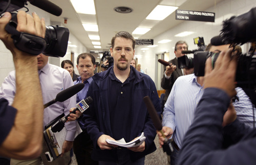Josh Powell, the husband of missing Utah woman Susan Powell, is surrounded by reporters as he leaves a Pierce County courtroom, Friday, Sept. 23, 2011, in Tacoma, Wash. Powell was attending a hearing regarding a motion for custody of his two children that was filed by his father-in-law, Chuck Cox. (AP Photo/Ted S. Warren)