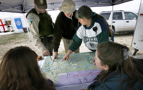 SCOTT SOMMERDORF  |  The Salt Lake Tribune Searchers coordinate at the command post with Ray Kelsey of the BLM, center, top, as they plan to scour the areas in and around Simpson Springs Saturday. The day-long effort turned up no trace of Susan Powell.