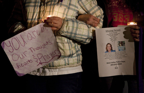 Cox family neighbors Miranda Cottle, left, and her mother, Tracy, of Puyallup, Wash., hold signs remembering Susan Cox Powell before a vigil for Powell at an LDS chapel in Puyallup, Wash., on Saturday to remember her three months after her disappearance.  Stephen Brashear