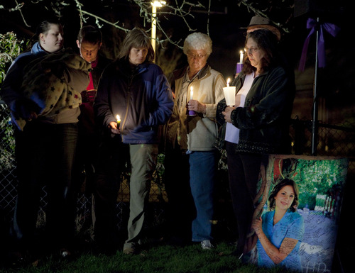 Photo by Stephen Brashear From left, Susan Cox Powell's sister Marie Moniz, nephew Patrick IV, brother-in-laws Patrick III, aunt Pam Cox, grandmother Anne Cox and mother Judy Cox take part in a vigil at the Church of Jesus Christ of Latter Day Saints in Puyallup, Wash., Saturday March 6, 2010,  to remember three months since her disappearance.