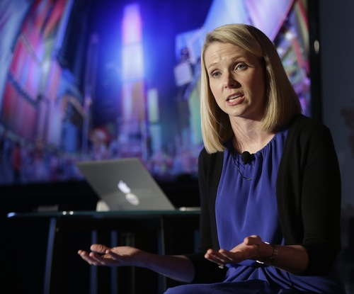 Yahoo CEO Marrissa Mayer speaks during a news conference Monday, May 20, 2013, in New York. Yahoo edged up 31 cents, or 1.2 percent, to $26.83 after the Internet company said it was buying online blogging forum Tumblr for $1.1 billion. (AP Photo/Frank Franklin II)
