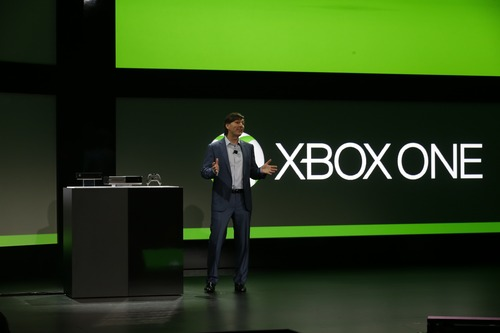 Microsoft Corp.'s Don Mattrick unveils the next-generation Xbox entertainment and gaming console system, Tuesday, May 21, 2013, at an event in Redmond, Wash. It's been eight years since the launch of the Xbox 360. The original Xbox debuted in 2001, and its high-definition successor premiered in 2005.  (AP Photo/Ted S. Warren)