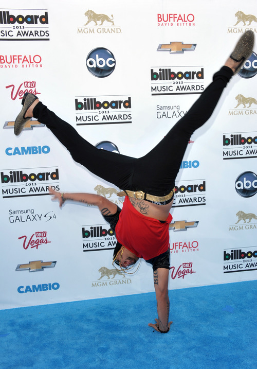 Sky Blu stands on one hand as he arrives at the Billboard Music Awards at the MGM Grand Garden Arena on Sunday, May 19, 2013 in Las Vegas. (Photo by John Shearer/Invision/AP)