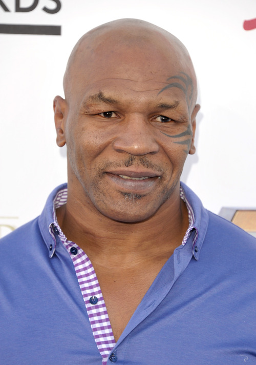 Mike Tyson arrives at the Billboard Music Awards at the MGM Grand Garden Arena on Sunday, May 19, 2013 in Las Vegas. (Photo by John Shearer/Invision/AP)