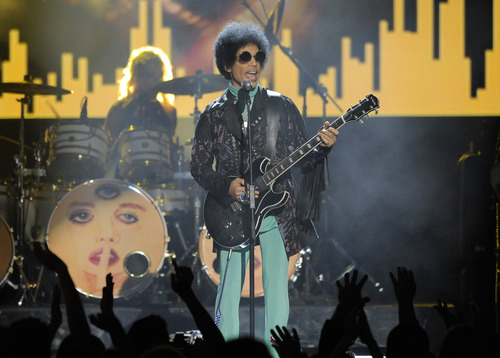 Prince performs at the Billboard Music Awards at the MGM Grand Garden Arena on Sunday, May 19, 2013 in Las Vegas. (Photo by Chris Pizzello/Invision/AP)