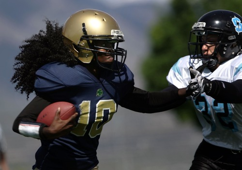 Kim Raff  |  The Salt Lake Tribune Utah JYNX player (left) Mixsa Kafi pushes away (right) Nevada Storm defender Jamie Martino during a Women's Football Alliance game at Taylorsville High School in Taylorsville on May 18, 2013. The WFA is a full contact women's football league