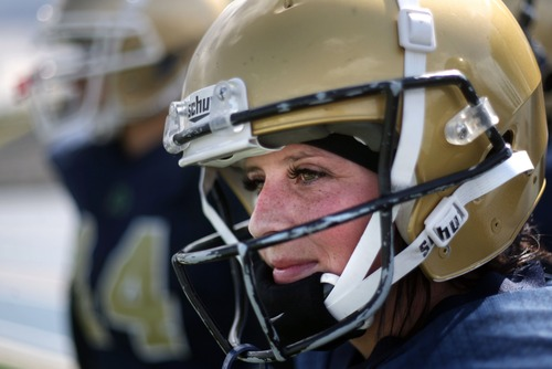 Kim Raff  |  The Salt Lake Tribune Utah JYNX player Gina Mondragon takes a break on the sidelines as her team plays against the Nevada Storm during a Women's Football Alliance game at Taylorsville High School in Taylorsville on May 18, 2013. The WFA is a full contact women's football league