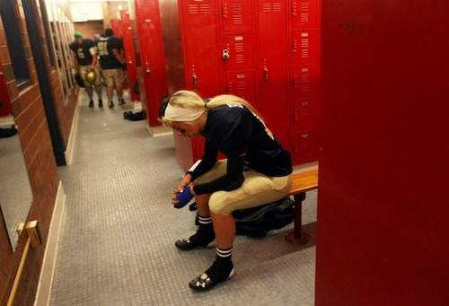 Kim Raff  |  The Salt Lake Tribune Utah JYNX player Amy Broadbent rests in the locker room during halftime against the Nevada Storm during a Women's Football Alliance game at Taylorsville High School in Taylorsville on May 18, 2013. The WFA is a full contact women's football league