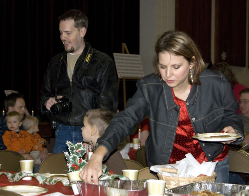 This image provided by Suzy Guzman shows Susan Powell, right, at a church function with her husband Josh Powell, left, Dec. 5, 2009 in West Valley City, Utah. Susan Powell, 28, was reported missing on Dec. 7, 2009. (AP Photo/Suzy Guzman)