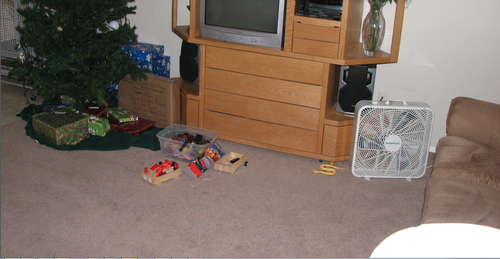 A photo taken by West Valley City, presumably on Dec. 7, 2009, police show a box fan sitting next to a couch. Early in the disappearance of Susan Powell, it was disclosed a fan was suspicously blowing on a wet carpet. Photo courtesy West Valley City police.