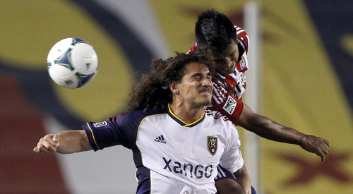 Real Salt Lake forward Devon Sandoval, left, bangs head with Chivas USA defender Joaquin Velazquez, right, after heading the ball during the first half of an MLS soccer game in Carson, Calif., Sunday, May 19, 2013. (AP Photo/Alex Gallardo)
