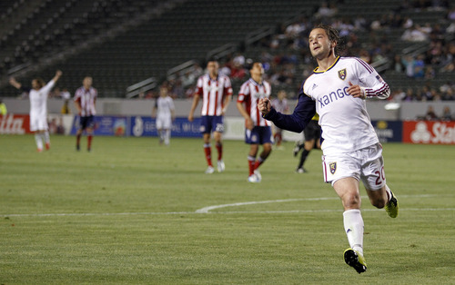 Real Salt Lake midfielder Ned Grabavoy (20) pumps his fist after scoring his second goal against Chivas USA during the second half of an MLS soccer game in Carson, Calif., Sunday, May 19, 2013. Real Salt Lake won the match 4-1.    (AP Photo/Alex Gallardo)
