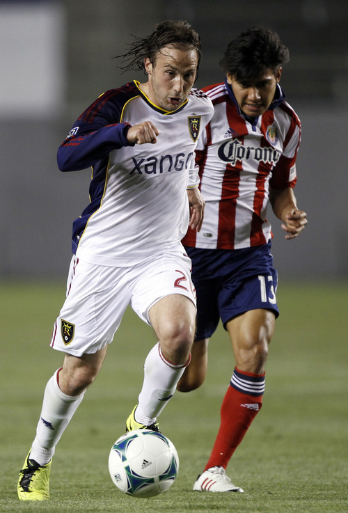 Real Salt Lake midfielder Ned Grabavoy, left, races to score his second goal with Chivas USA defender Ante Jazic, right, defending, during the second half of an MLS soccer game in Carson, Calif., Sunday, May 19, 2013. Real Salt Lake won the match 4-1.    (AP Photo/Alex Gallardo)