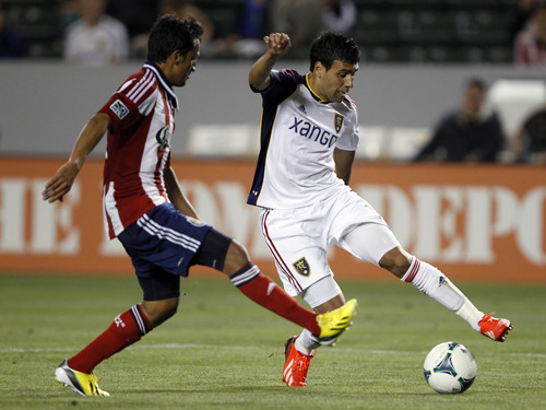 Real Salt Lake midfielder Javier Morales, right, stops the ball with Chivas USA midfielder Martin Ponce defending during the second half of an MLS soccer game in Carson, Calif., Sunday, May 19, 2013. Real Salt Lake won the match 4-1.    (AP Photo/Alex Gallardo)