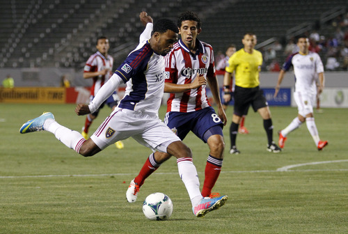 Real Salt Lake forward Robbie Findley (10) rears back to take a shot with Chivas USA midfielder Edgar Mejia (8) defending during the second half of an MLS soccer game in Carson, Calif., Sunday, May 19, 2013. Real Salt Lake won the match 4-1.    (AP Photo/Alex Gallardo)