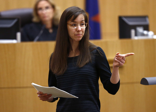 Jodi Arias points to her family as a reason for the jury to give her a life in prison sentence instead of the death penalty on Tuesday, May 21, 2013, during the penalty phase of her murder trial at Maricopa County Superior Court in Phoenix.  Arias was convicted of first-degree murder in the stabbing and shooting to death of Travis Alexander, 30, in his suburban Phoenix. (AP Photo/The Arizona Republic, Rob Schumacher, Pool)