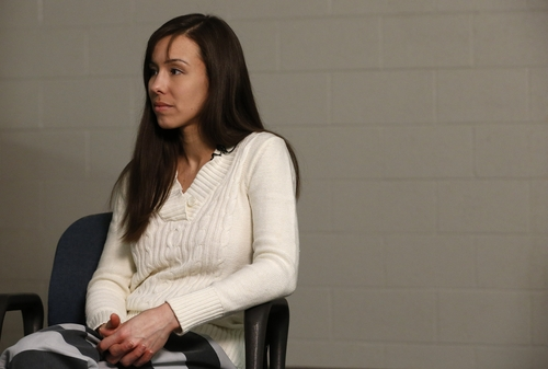 Convicted killer Jodi Arias listens to a question asked of her before speaking during an interview at the Maricopa County Estrella Jail on Tuesday, May 21, 2013, in Phoenix.  Arias was convicted recently of killing her former boyfriend Travis Alexander in his suburban Phoenix home back in 2008, made a plea for life in prison, instead of execution, saying she can contribute to society if allowed to live. (AP Photo/Ross D. Franklin)