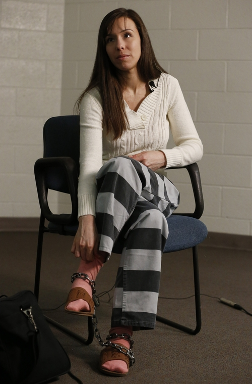 Convicted killer Jodi Arias pauses for a moment during an interview at the Maricopa County Estrella Jail on Tuesday, May 21, 2013, in Phoenix.  Arias was convicted recently of killing her former boyfriend Travis Alexander in his suburban Phoenix home back in 2008, made a plea in court Tuesday for life in prison, instead of execution, saying she can contribute to society if allowed to live. (AP Photo/Ross D. Franklin)