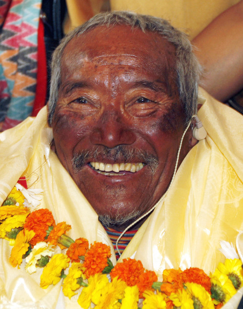 FILE - In this May 31, 2008 file photo, Min Bahadur Sherchan, who became the oldest person to climb Mount Everest on May 25, 2008 smiles on his arrival in Katmandu, Nepal. Yuichiro Miura, an 80-year-old Japanese extreme skier who just missed becoming the oldest man to reach the summit of Mount Everest five years ago is back on the mountain to make another attempt at the title. Unfortunately for Miura, Sherchan, the slightly older man who nabbed the record a day before he could in 2008 is fast on his heels. (AP Photo/Binod Joshi, File)