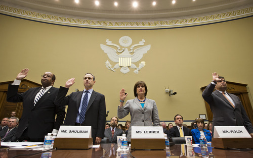 From left, Treasury Inspector General for Tax Administration J. Russell George,  former IRS Commissioner Douglas Shulman, Lois Lerner, head of the IRS unit that decides whether to grant tax-exempt status to groups, and Deputy Treasury Secretary Neal Wolin, are sworn in on Capitol Hill in Washington, Wednesday, May 22, 2013, prior to testifying before the House Oversight Committee hearing to investigate the extra scrutiny the Internal Revenue Service gave Tea Party and other conservative groups that applied for tax-exempt status.  (AP Photo/J. Scott Applewhite)