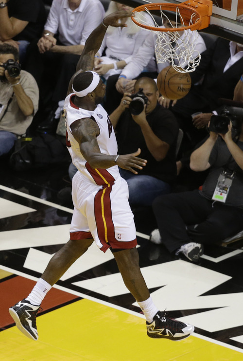 Miami Heat small forward LeBron James (6) dunks the ball during the second half of Game 1 in their NBA basketball Eastern Conference finals playoff series against the Indiana Pacers, Wednesday, May 22, 2013 in Miami. (AP Photo/Wilfredo Lee)