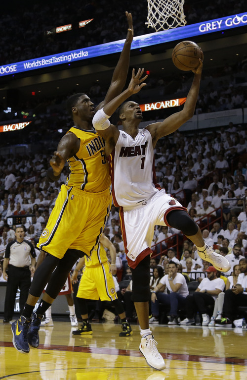 Indiana Pacers center Roy Hibbert (55) defends Miami Heat center Chris Bosh (1) as he drives to the basket during the second half of Game 1 in their NBA basketball Eastern Conference finals playoff series, Wednesday, May 22, 2013 in Miami. (AP Photo/Lynne Sladky)