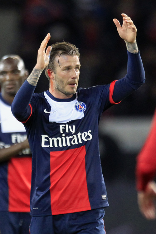 Paris Saint Germain's midfielder David Beckham from England, cries as he leaves the field, during his French League One soccer match against Brest, at the Parc des Princes stadium, in Paris, Saturday, May 18, 2013. (AP Photo/Thibault Camus)