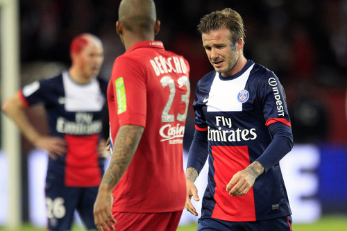 Paris Saint Germain's midfielder David Beckham from England, right, cries as he leaves the field, during his French League One soccer match against Brest, at the Parc des Princes stadium, in Paris, Saturday, May 18, 2013. (AP Photo/Thibault Camus)
