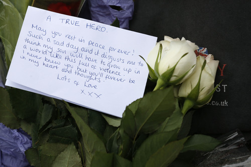 A floral tribute in memory of the victim is seen outside the Royal Artillery Barracks near the scene of a terror attack in Woolwich, southeast London, Thursday, May 23, 2013. The British government's emergency committee met Thursday after two attackers killed a man in a daylight attack in London that raised fears terrorism had returned to the capital. (AP Photo/Sang Tan)