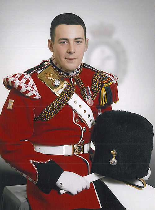 """In this undated image released Thursday May 23, 2013, by the British Ministry of Defence, showing Lee Rigby known as """"Riggers"""" to his friends, who is identified by the MOD as the serving member of the armed forces who was attacked and killed by two men in the Woolwich area of London on Wednesday.  The Ministry web site included the statement """"It is with great sadness that the Ministry of Defence must announce that the soldier killed in yesterday's incident in Woolwich, South East London, is believed to be Drummer Lee Rigby of 2nd Battalion The Royal Regiment of Fusiliers."""" (AP Photo / MOD)"""