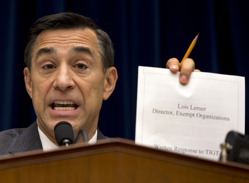 House Oversight Committee Chairman Rep. Darrell Issa, R-Calif. holds up a document as he speaks to IRS official Lois Lerner on Capitol Hill in Washington, Wednesday, May 22, 2013, during the committee's hearing to investigate the extra scrutiny IRS gave to Tea Party and other conservative groups that applied for tax-exempt status.  Lerner told the committee she did nothing wrong and then invoked her constitutional right to not answer lawmakers' questions. (AP Photo/Carolyn Kaster)