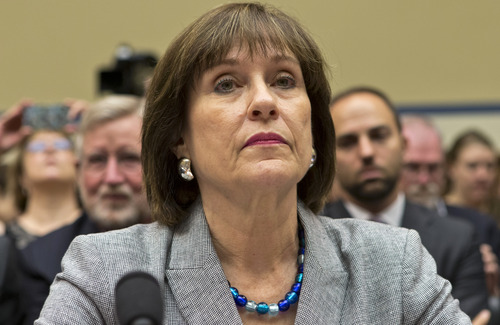 Lois Lerner, head of the IRS unit that decides whether to grant tax-exempt status to groups, listens on Capitol Hill in Washington, Wednesday, May 22, 2013, at the start of a House Oversight and Government Reform Committee hearing to investigate the extra scrutiny the IRS gave to Tea Party and other conservative groups that applied for tax-exempt status. Lerner later invoked her constitutional right to not answer questions and was dismissed by House Oversight Committee Chairman Darrell Issa, R-Calif.    (AP Photo/J. Scott Applewhite)