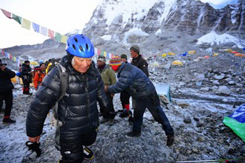 In this Thursday, May 16, 2013 photo distributed by Miura Dolphins, 80-year-old Japanese adventurer Yuichiro Miura leaves the base camp at 5,300 meters (17,388 feet) for his attempt to scale the summit of Mount Everest. According to his management office, Miura plans to accomplish the ascent on Thursday, May 23 to be the world's oldest person to reach the world's highest peak. (AP Photo/Miura Dolphins)  MANDATORY CREDIT