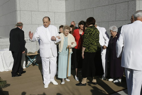 Rick Egan | The Salt Lake Tribune  LDS President Thomas S. Monson, and his wife, Frances, walk away from the cornerstone after it was laid in a ceremony at the new Draper Temple.