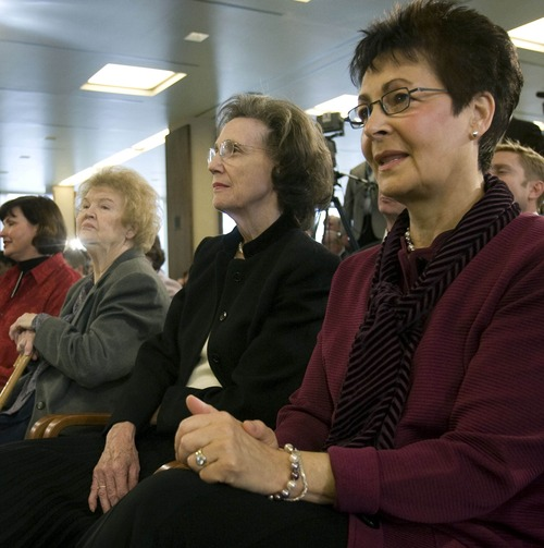 Steve Griffin | The Salt Lake Tribune  (left to right) Frances Beverly Monson (with cane), Kathleen Eyring and Harriet Uchtdorf watch as their husbands Thomas S. Monson, Henry B. Eyring and Dieter F.  Uchtdorf are announced as the new First Presidency of The Church of Jesus Christ of Latter-day Saints during a press conference at the LDS Church Office Building in Salt Lake on February 4, 2008.  Thomas S. Monson, was named President of the LDS church, Henry B. Eyring was named first counselor,  and Dieter F.  Uchtdorf was named second counselor.