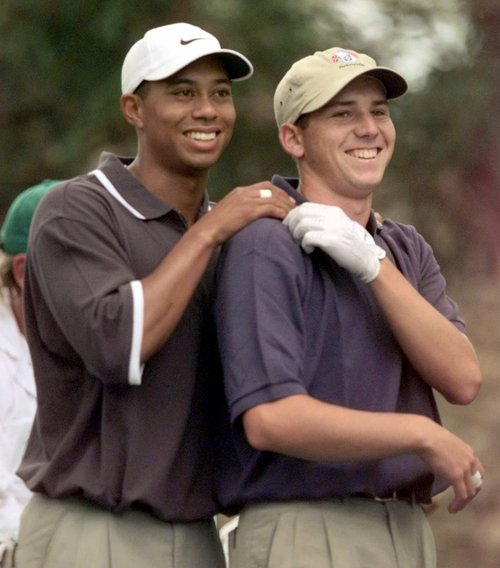 "FILE - In this April 9, 1999 file photo, Tiger Woods, left, grabs the shoulders of Sergio Garcia, from Spain, after Garcia's drive on the second hole during the second round of the Masters golf turnament at the Augusta National Golf Club in Augusta, Ga. Garcia was at a European Tour awards dinner Tuesday night, May 21, 2013 when he was jokingly asked if he would have Woods over for dinner during the U.S. Open. The Spaniard replied, ""We'll have him round every night. We will serve fried chicken."" Woods took to Twitter on Wednesday, May 22, 2013 and said the comment wasn't silly, rather it was wrong and hurtful. (AP Photo/Elise Amendola, File)"