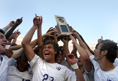 Kim Raff  |  The Salt Lake Tribune Lehi players celebrate defeating Bingham 2-0 during the UHSAA 5A State Championship at Rio Tinto Stadium in Sandy on May 23, 2013.