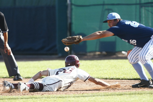 Chris Detrick     The Salt Lake Tribune Maple Mountain's Kaden Poulson (20) slides safely back to first base as the throw goes past Salem Hills' Daniel Centeno (26) during the game at Brent Brown Ballpark at Utah Valley University Thursday May 23, 2013. Salem Hills defeated Maple Mountain 7-2.