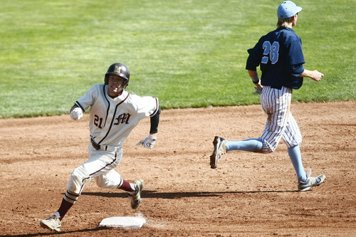 Chris Detrick     The Salt Lake Tribune Maple Mountain's Jonah Flinders (21) runs around second base after hitting a triple during the game at Brent Brown Ballpark at Utah Valley University Thursday May 23, 2013. Salem Hills defeated Maple Mountain 7-2.