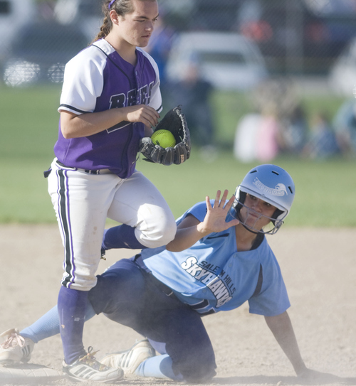 Keith Johnson | The Salt Lake Tribune  Salem Hills' Kaylee Simons calls for time after sliding safely into third base under the tag of Box Elder's Sadie Blacker during the 4A softball championship May 23, 2013. Salem Hills went on the beat Box Elder for the title.