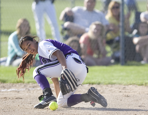 Keith Johnson | The Salt Lake Tribune  Box Elder shortstop Karly Bunderson looks for the ball after stopping a hard ground ball during the 4A softball championship May 23, 2013. Salem Hills went on to beat Box Elder for the title.