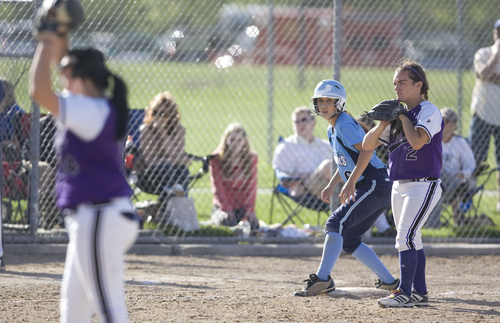 Keith Johnson | The Salt Lake Tribune  Salem Hills' Hannah Rogers stands on third next to Box Elder third baseman Sadie Blacker as they wait for Abigayle Martin to deliver a pitch during the 4A softball championship May 23, 2013. Salem Hills defeated Box Elder for the title.