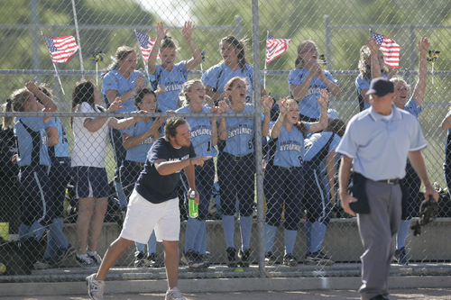 Keith Johnson | The Salt Lake Tribune  The Salem Hills dugout cheers for their base-runners during the 4A softball championship game May 23, 2013. Salem Hills beat Box Elder for the title.