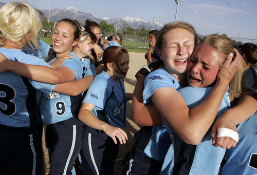 Keith Johnson | The Salt Lake Tribune  Kenna Davis (far right) and Amelia Weight hug as they celebrate with their teammates after winning the 4A softball championship by beating Box Elder May 23, 2013.